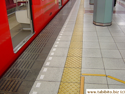 Ubiquitous yellow line with raised dots for the visually impared