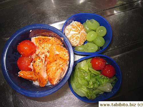 Grilled salmon, sauteed lettuce, seared cherry tomatoes, mandarin and grapes