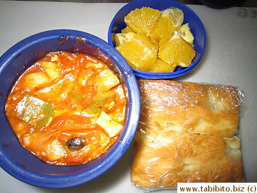 Vegetable stew, focaccia, orange