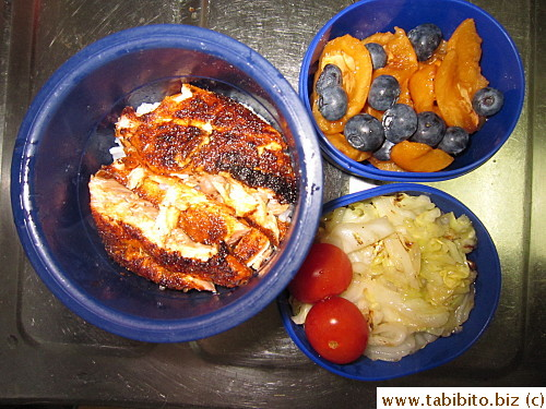 Cajun salmon, sauteed cabbage, cherry tomatoes, biwa and blueberries