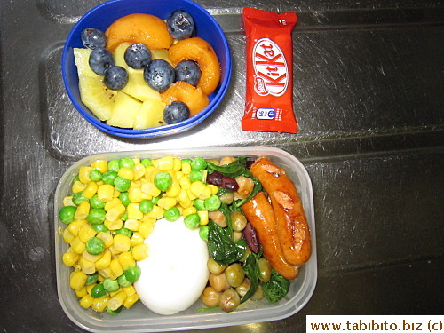 Veggies, beans, soft-boiled egg, sausages; kiwi, biwa and blueberries, KitKat